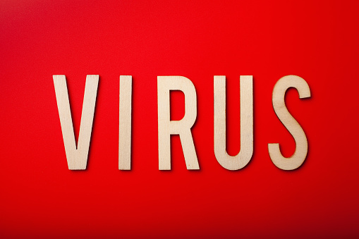 virus word text wooden letter on red background corona virus covid-19